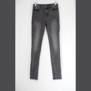 Charcoal black skinny jeans with zip up cuff